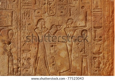Pharoah presenting a gift to the ithyphallic god Min at the great ancient Egyptian temple of Amun at Karnak, Luxor in Egypt - stock photo
