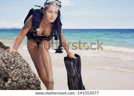 Phashion lifestyle portrait young woman in underwater equipment at the outdoor - stock photo