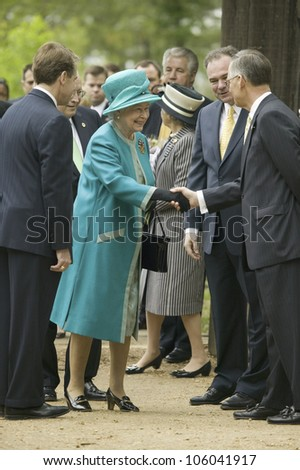 Phil Emerson (left) and Her Majesty Queen Elizabeth II shaking hand of Senator Tommy Norment during her official visit James Fort, Jamestown Settlement, Virginia on May 4, 2007. - stock photo