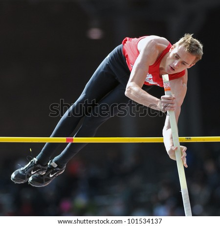 PHILADELPHIA - APRIL 28: Austin Miller from Herndon HS competes in the boys high school pole vault championship at the Penn Relays April 28, 2012 in Philadelphia. - stock photo