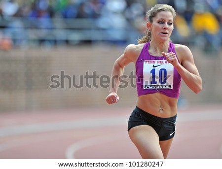 PHILADELPHIA - APRIL 28: Jesse Carlin runs in the Olympic Development women's mile competition at the 2012 Penn Relays April 28, 2012 in Philadelphia. - stock photo