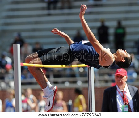 PHILADELPHIA - APRIL 29: Naval Academy high jumper Joshua Houston attempts to clear the bar early in the College Men's High Jump Competition at the 117th Penn Relays on April 29, 2011 in Philadelphia, PA - stock photo
