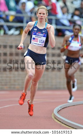 PHILADELPHIA - APRIL 28: Phoebe Wright from the USA runs the third leg of the sprint medley at the Penn Relays April 28, 2012 in Philadelphia. - stock photo