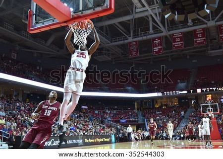 PHILADELPHIA - DECEMBER 13: Temple Owls guard Quenton DeCosey (25) elevates for a slam dunk during the Big 5 basketball game December 13, 2015 in Philadelphia. - stock photo