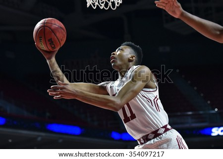 PHILADELPHIA - DECEMBER 19: Temple Owls guard Trey Lowe (11) takes a shot during the basketball game December 19, 2015 in Philadelphia.  - stock photo