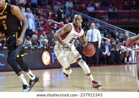 PHILADELPHIA - December 10: Temple Owls guard Will Cummings (2) drives to the basket during the NCAA basketball game December 10, 2014 in Philadelphia. - stock photo