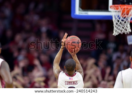 PHILADELPHIA - DECEMBER 22: Temple Owls guard Will Cummings (2) shoots a free throw during the NCAA basketball game December 22, 2014 in Philadelphia.  - stock photo