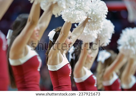 PHILADELPHIA - December 10: The Temple Owls cheerleaders perform during the NCAA basketball game December 10, 2014 in Philadelphia. - stock photo