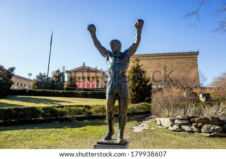 PHILADELPHIA - FEB 27: The Rocky Statue in Philadelphia, USA, on February 27, 2014. Originally created for the movie Rocky III, the sculpture is now a real-life monument to a celluloid hero - stock photo