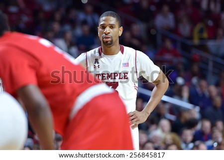 PHILADELPHIA - FEBRUARY 26: Temple Owls guard Quenton DeCosey (25) blocks out a Houston player for a rebound during the AAC conference college basketball game  February 26, 2015 in Philadelphia.  - stock photo