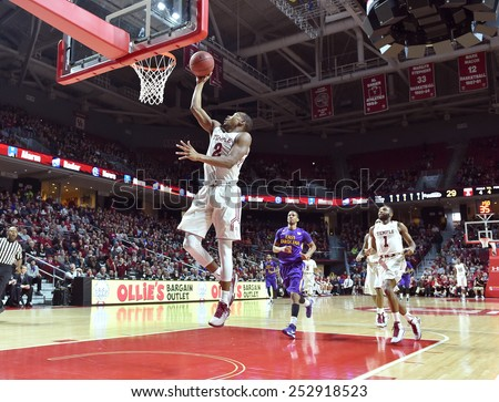 PHILADELPHIA - FEBRUARY 14: Temple Owls guard Will Cummings (2) lifts off for a lay-up during the AAC conference college basketball game January 14, 2015 in Philadelphia.  - stock photo