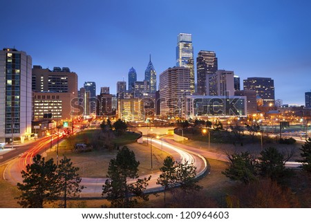 Philadelphia. Image of Philadelphia skyline and busy roads during twilight blue hour. - stock photo