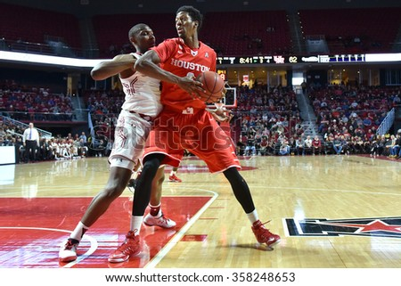 PHILADELPHIA - JANUARY 2: Houston Cougars forward Danrad Knowles (0) looks for room to take a shot during the American Athletic Conference basketball game January 2, 2016 in Philadelphia.  - stock photo