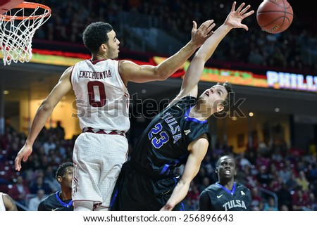 PHILADELPHIA - January 10: Temple Owls forward Obi Enechionyia (0) battles for a rebound during the AAC conference college basketball game January 10, 2015 in Philadelphia.  - stock photo
