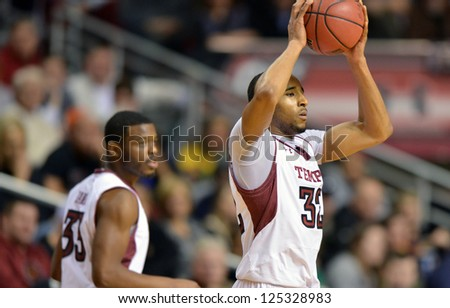 PHILADELPHIA - JANUARY 19: Temple Owls forward Rahlir Hollis-Jefferson (32) looks for a pass during the Atlantic 10 basketball conference game against St. Bonaventure January 19, 2013 in Philadelphia. - stock photo
