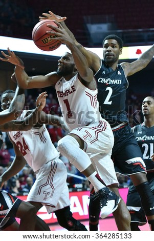 PHILADELPHIA - JANUARY 16: Temple Owls guard Josh Brown (1) drives to the basket during the American Athletic Conference basketball game January 16, 2016 in Philadelphia.  - stock photo