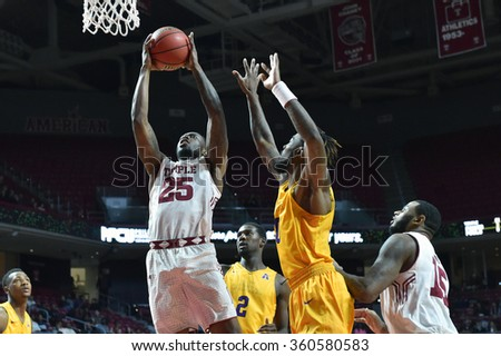 PHILADELPHIA - JANUARY 9: Temple Owls guard Quenton DeCosey (25) takes a shot during the American Athletic Conference  basketball game January 9, 2016 in Philadelphia.  - stock photo