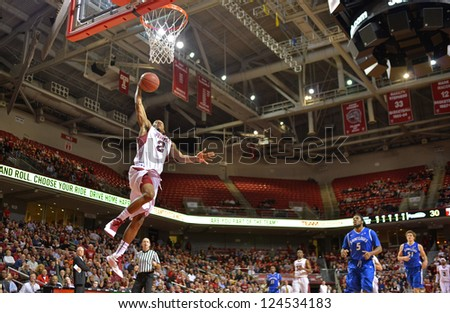 PHILADELPHIA - JANUARY 12: Temple Owls Will Cummings (#2) elevates for a slam dunk during the Atlantic 10 basketball conference game against St. Louis January 12, 2013 in Philadelphia. - stock photo