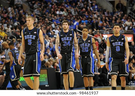 PHILADELPHIA - JANUARY 4: The Duke men's basketball teams heads onto the court following a timeout during the NCAA basketball game between Duke and Temple January 4, 2012 in Philadelphia. - stock photo