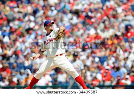 PHILADELPHIA - JULY 26: Philadelphia Phillies pitcher Joe Blanton delivers a pitch during the July 26, 2009 game in Philadelphia. - stock photo
