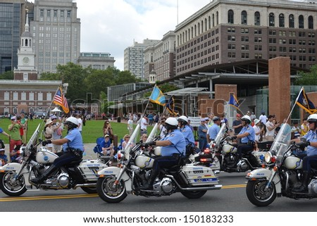 PHILADELPHIA- JULY 4: The Independence Day Parade makes its way along Market St. on July 4, 2013 in Philadelphia, PA. - stock photo