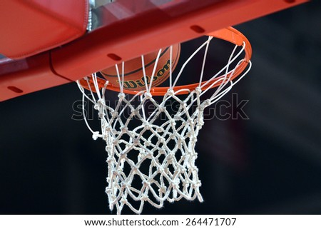 PHILADELPHIA - MARCH 25: A basketball prepares to drop the hoop and net during the NIT quarterfinal basketball game March 18, 2015 in Philadelphia. - stock photo
