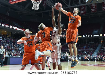 PHILADELPHIA - MARCH 18: Bucknell Bison forward Zach Thomas (23) blocks a shot during the NIT first round basketball game March 18, 2015 in Philadelphia. - stock photo