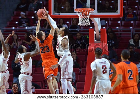 PHILADELPHIA - MARCH 18: Temple Owls forward/center Devontae Watson (23) blocks a shot during the NIT first round basketball game March 18, 2015 in Philadelphia. - stock photo