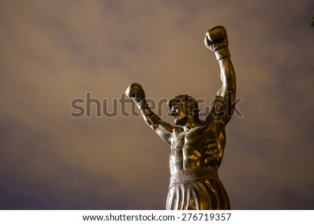 PHILADELPHIA - May 6: The Rocky Statue in Philadelphia, USA, on May 6, 2015. Originally created for the movie Rocky III, the sculpture is now a real-life monument to a celluloid hero - stock photo