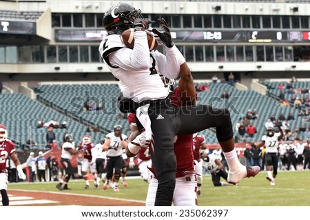 PHILADELPHIA - NOVEMBER 29: Cincinnati Bearcats running back Tion Green (7) makes a leaping catch for a touchdown during the football game November 29, 2014 in Philadelphia. - stock photo