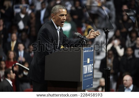 PHILADELPHIA - NOVEMBER 2: President Barack Obama urges supporters to spread the word and get neighbors to the polls help the outcome of a close election on November 2, 2014 in Philadelphia.    - stock photo