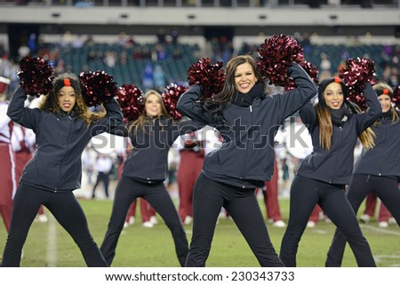 PHILADELPHIA - NOVEMBER 8: The Temple Diamond Gems dance team performs during the AAC football game November 8, 2014 in Philadelphia, PA.  - stock photo
