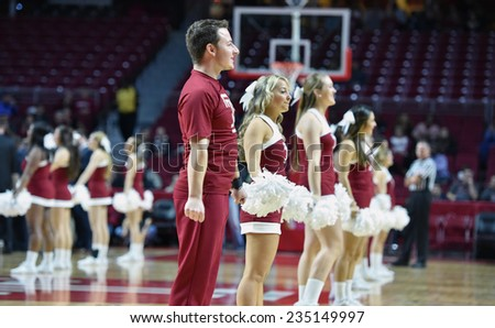 PHILADELPHIA - NOVEMBER 30: The Temple Owls cheerleaders perform on the court during the NCAA basketball game November 30, 2014 in Philadelphia. - stock photo