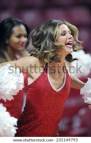 PHILADELPHIA - NOVEMBER 30: The Temple Owls Diamond Gems dance team performs on the court during the NCAA basketball game November 30, 2014 in Philadelphia. - stock photo