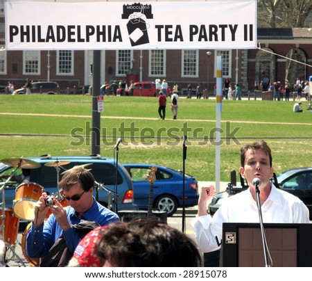 PHILADELPHIA, PA - APRIL 18: A protester speaks at tea party protest April 18, 2009 in Philadelphia. The protest is a modern-day protest to the government's spending of billions of dollars. - stock photo