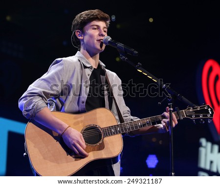 PHILADELPHIA, PA - December 10, 2014: Shawn Mendes performs at the Wells Fargo Center on December 10, 2014 in Philadelphia.  - stock photo