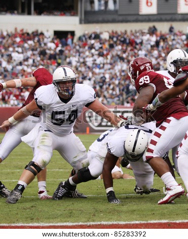 PHILADELPHIA, PA. - SEPTEMBER 17: Penn State Center Matt Stankewitch blocks during an extra point attempt against Temple on September 17, 2011 at Lincoln Financial Field in Philadelphia, PA. - stock photo