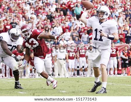 PHILADELPHIA, PA. - SEPTEMBER 17: Penn State quarterback Matt McGloin avoids the rush against Temple on September 17, 2011 at Lincoln Financial Field in Philadelphia, PA.  - stock photo