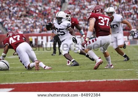 PHILADELPHIA, PA. - SEPTEMBER 17: Penn State running back Silas Redd looks for running room during a game against Temple on September 17, 2011 at Lincoln Financial Field in Philadelphia, PA. - stock photo