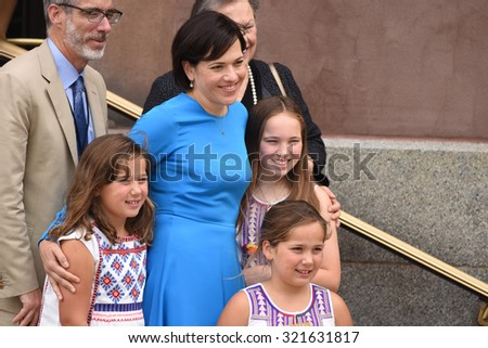 PHILADELPHIA, PA - SEPTEMBER 26 2015: Pope Francis celebrated mass at the Cathedral Basilica of Peter & Paul in downtown Philadelphia. Family leaving cathedral after mass. - stock photo