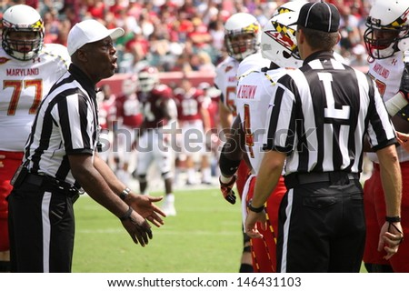 PHILADELPHIA, PA. - SEPTEMBER 8: Referees confer  before making a call during the Maryland / Temple game on September 8, 2012 at Lincoln Financial Field in Philadelphia, PA.  - stock photo