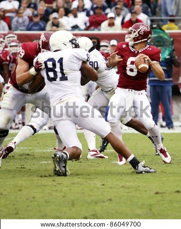 PHILADELPHIA, PA. - SEPTEMBER 17: Temple Quarterback Mike Gerardi passes under pressure during a game against Penn State on September 17, 2011 at Lincoln Financial Field in Philadelphia, PA. - stock photo