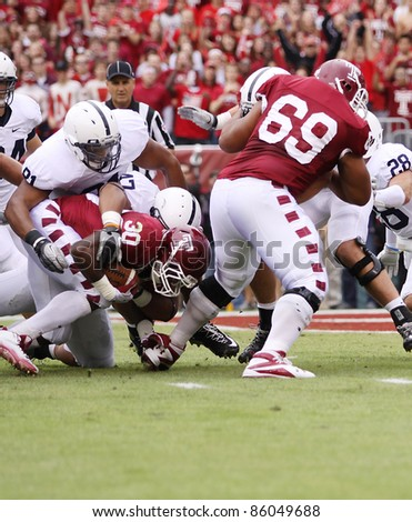 PHILADELPHIA, PA. - SEPTEMBER 17: Temple running back Bernard Pierce is tackled short of the goal line against Penn State on September 17, 2011 at Lincoln Financial Field in Philadelphia, PA. - stock photo