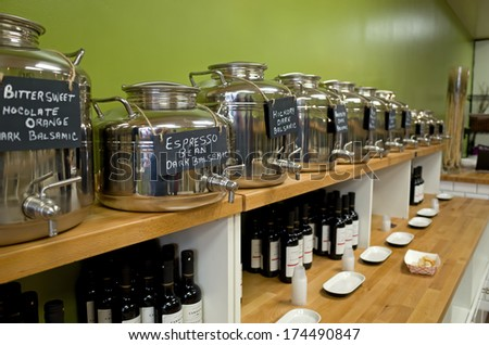 PHILADELPHIA, PA, USA - FEBRUARY 1, 2014: Photo of Espresso Bean Dark Balsamic Vinegar sitting on the shelf with many vinegars and oils in Cardenas Taproom in the midst of Philadelphia's Italian Market. - stock photo