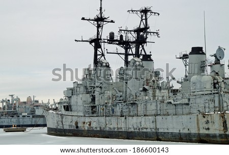 PHILADELPHIA, PENNSYLVANIA - February 16, 2014:  Old U.S. Navy Ships. Decommissioned U.S. Navy frigate and other warships in the Inactive Ships Maintenance facility at the Philadelphia navy yard.   - stock photo