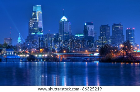 Philadelphia Pennsylvania Skyline at Night:  A view of Philadelphia, Pennsylvania�s cityscape overlooking the Schuylkill River at night.  An HDR image from 5 exposures. - stock photo