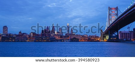 Philadelphia skyline reflected in the Delaware river under a twilight - stock photo