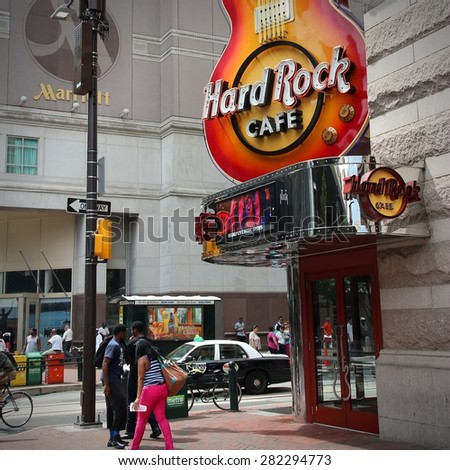 PHILADELPHIA, USA - JUNE 11, 2013: People walk past Hard Rock Cafe in Philadelphia. There are 175 Hard Rock locations in 53 countries. - stock photo