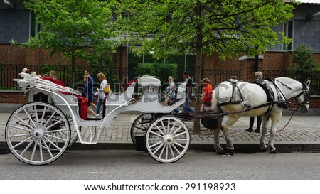 PHILADELPHIA, USA - MAY 9: Horse and carriage rides in Philadelphia, USA, as seen on May 9, 2015. This is a popular tourist attraction in front of the Independence Hall. - stock photo