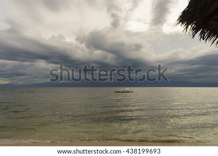 philippine wooden boat waiting tropical storm on surface calm se - stock photo
